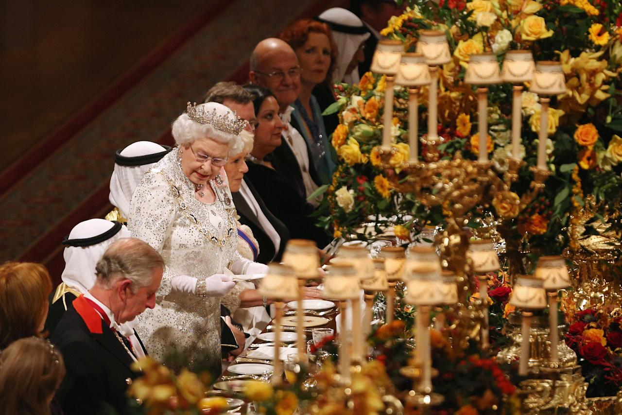 Queen Elizabeth II delivers a speech during a State Banquet for His Highness the Amir Sheikh Sabah Al-Ahmad Al-Jaber Al-Sabah of Kuwait in Windsor Castle on the first day of his State Visit to the UK.