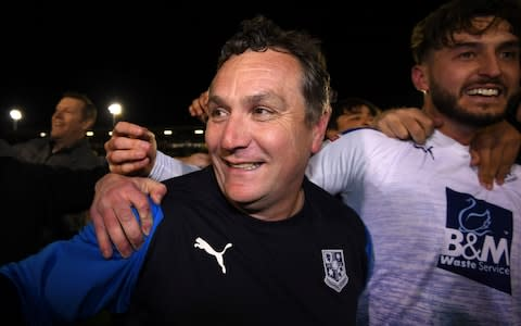 Micky Mellon, Tranmere's manager, celebrates his side reaching the League Two play-off final - Credit: Getty Images