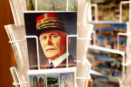"FILE PHOTO: A postcard featuring French Marshal Philippe Petain is seen for sale at 40 cents at the souvenir shop of the Ossuary of Douaumont near Verdun, northeastern France, March 30, 2014. On the back of the the postcard you can read, ""Marshall Petain, victorious at Verdun 1916, Commander in Chief of the French Army 1917-1918, Chief of State July 10, 1940 - August 20 1944. REUTERS/Charles Platiau/File Photo"
