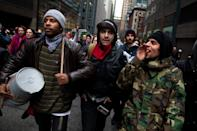 Occupy Wall Street protestors drum and chant during a march on the offices of pharmaceutical giant Pfizer, Wednesday, Feb. 29, 2012, in New York. There was a heavy police presence around the 42nd Street area as the demonstration began Wednesday morning outside. (AP Photo/John Minchillo)