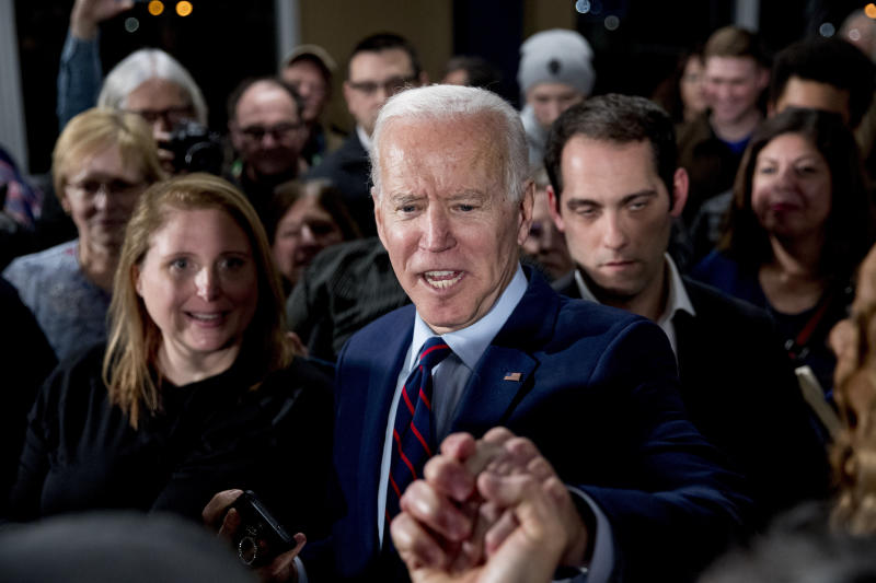 Democratic presidential candidate Joe Biden greets members of the audience at a campaign rally at Modern Woodmen Park, Sunday, Jan. 5, 2020, in Davenport, Iowa. (Photo: Andrew Harnik/AP)
