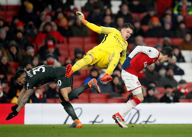 """Soccer Football - Premier League - Arsenal vs Manchester City - Emirates Stadium, London, Britain - March 1, 2018 Manchester City's Ederson and Nicolas Otamendi in action with Arsenal's Mesut Ozil REUTERS/David Klein EDITORIAL USE ONLY. No use with unauthorized audio, video, data, fixture lists, club/league logos or """"live"""" services. Online in-match use limited to 75 images, no video emulation. No use in betting, games or single club/league/player publications. Please contact your account representative for further details. TPX IMAGES OF THE DAY"""