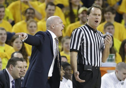 Penn State head coach Pat Chambers, front left, argues a call during the first half of an NCAA college basketball game against Michigan at Crisler Center in Ann Arbor, Mich., Sunday, Feb. 17, 2013. (AP Photo/Carlos Osorio)