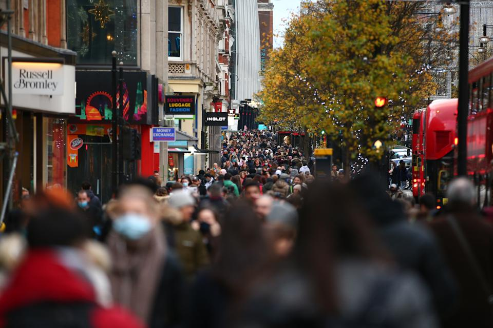 Shoppers, some wearing face masks, walk along a busy Oxford Street in London, England, on December 5, 2020. London has returned to so-called Tier 2 or 'high alert' coronavirus restrictions since the end of the four-week, England-wide lockdown last Wednesday, meaning a reopening of non-essential shops and hospitality businesses as the festive season gets underway. Rules under all three of England's tiers have been strengthened from before the November lockdown, however, with pubs and restaurants most severely impacted. In London's West End, meanwhile, Oxford Street and Regent Street were both packed with Christmas shoppers this afternoon, with the retail sector hoping for a strong end to one of its most difficult years. (Photo by David Cliff/NurPhoto via Getty Images)