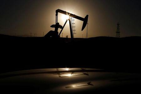 FILE PHOTO - A pump jack is seen at sunrise near Bakersfield