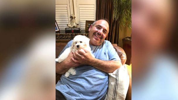 PHOTO: James Xuereb of Ontario was overcome with emotion when his family surprised him with a new bichon frise puppy after he recently lost two of his beloved dogs. (Jaleen Xuereb)