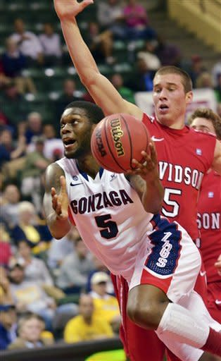Gonzaga guard Gary Bell Jr., (5) drives to the basket past Davidson guard JP Kuhlman during the first half of an NCAA college basketball game at the Old Spice Classic in Kissimmee, Fla., Sunday, Nov. 25, 2012. (AP Photo/Roberto Gonzalez)