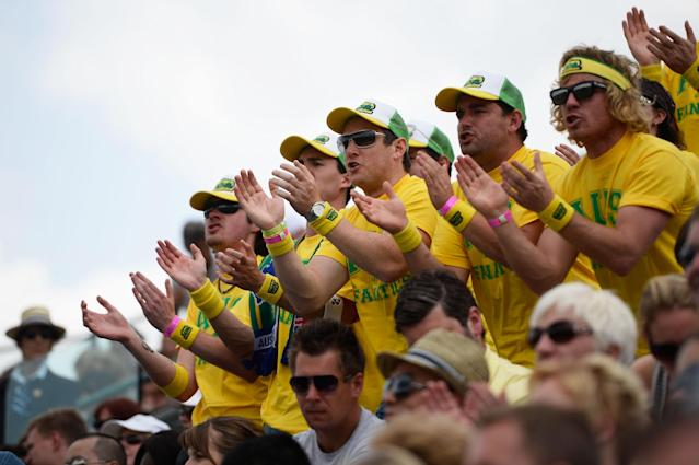 LONDON, ENGLAND - JUNE 26: Australia fans show their support for Lleyton Hewitt of Australia during his Gentlemen's Singles second round match against Dustin Brown of Germany on day three of the Wimbledon Lawn Tennis Championships at the All England Lawn Tennis and Croquet Club on June 26, 2013 in London, England. (Photo by Dennis Grombkowski/Getty Images)