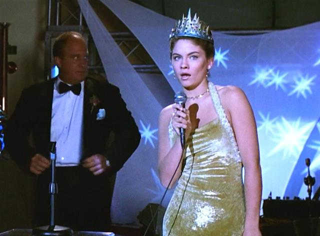 <p>Though she ends up stealing the crown from Rachael, Jode Lyn O'Keefe, who plays Taylor Vaughan, looks great in her gold crushed-velvet halter dress. Earlier in the evening, she also led the most epic prom dance scene in history. (Photo: Miramax Films) </p>