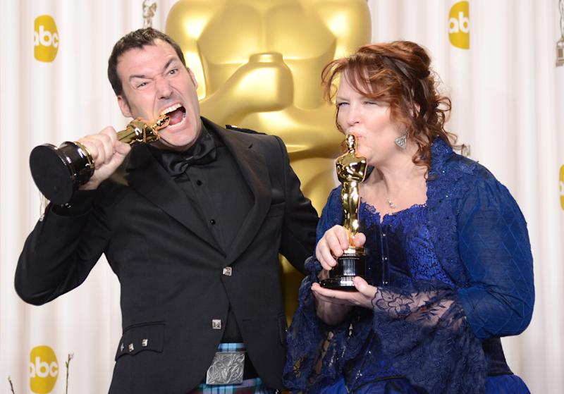 "HOLLYWOOD, CA - FEBRUARY 24: Directors Mark Andrews and Brenda Chapman, winners of the Best Animated Feature award for ""Brave,"" pose in the press room during the Oscars held at Loews Hollywood Hotel on February 24, 2013 in Hollywood, California. (Photo by Jason Merritt/Getty Images)"