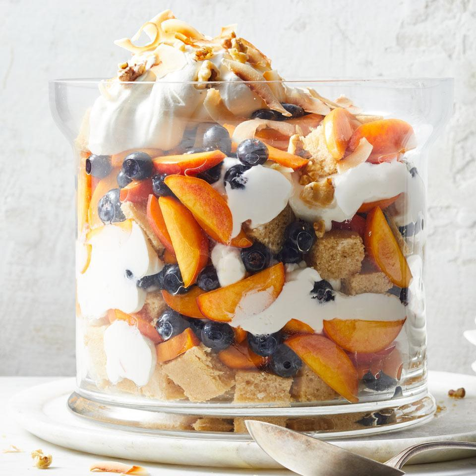 <p>This stunning fruit-filled trifle is a perfect make-ahead dessert for summer barbecues and dinner parties. Resist the urge to dig in until the trifle has chilled for at least a few hours--that time lets the flavors mingle and allows the cake to absorb the rum and fruit juices.</p>