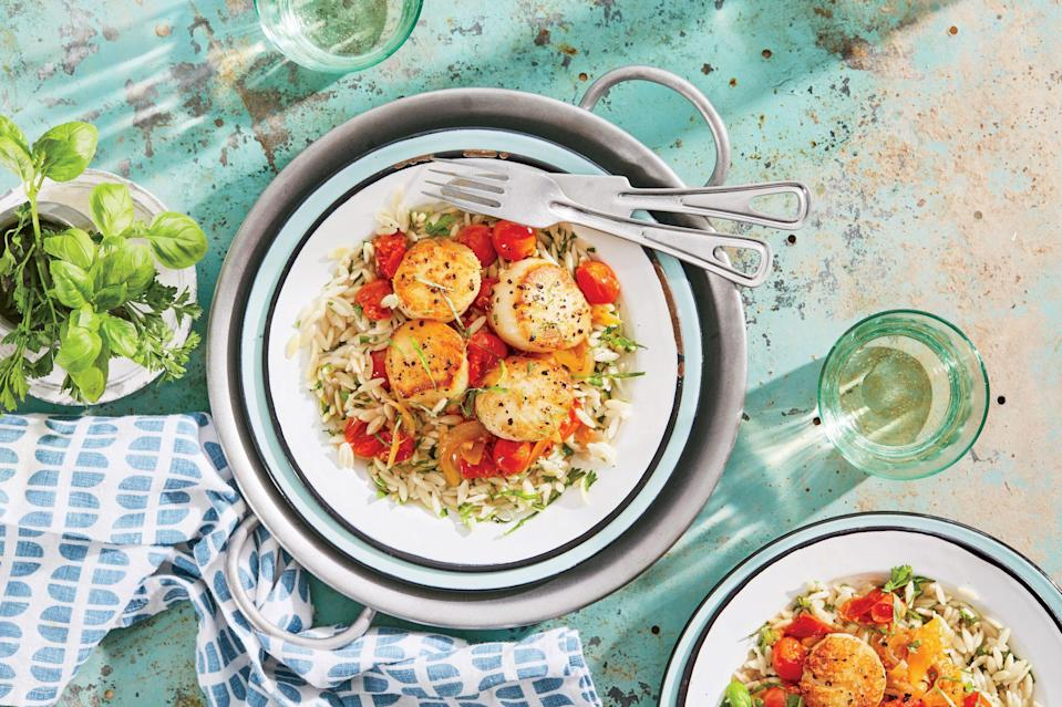 """<p><strong>Recipe: </strong><a href=""""https://www.southernliving.com/recipes/seared-scallops-fresh-tomato-basil-sauce-orzo-recipe"""" rel=""""nofollow noopener"""" target=""""_blank"""" data-ylk=""""slk:Seared Scallops with Fresh Tomato-Basil Sauce and Orzo"""" class=""""link rapid-noclick-resp""""><strong>Seared Scallops with Fresh Tomato-Basil Sauce and Orzo</strong></a></p> <p>This 30-minute supper looks straight from a five-star restaurant.</p>"""