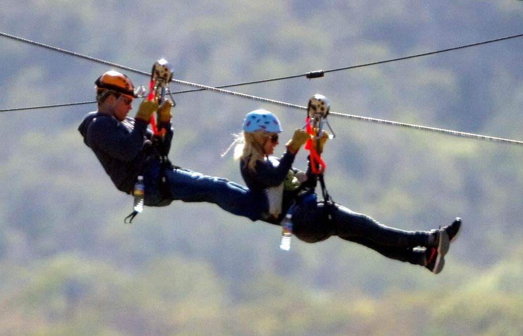 """After spending Christmas in Hawaii, Paris Hilton and her boyfriend Cy Waits headed to Cabo, where they went ziplining at Wild Canyon Park. Who knew Paris was so adventurous? Machette/<a href=""""http://www.infdaily.com"""" target=""""new"""">INFDaily.com</a> - December 31, 2010"""