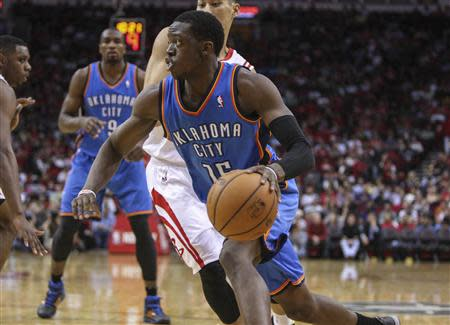 Apr 4, 2014; Houston, TX, USA; Oklahoma City Thunder guard Reggie Jackson (15) drives the ball during the third quarter against the Houston Rockets at Toyota Center. The Rockets defeated the Thunder 111-107. Mandatory Credit: Troy Taormina-USA TODAY Sports
