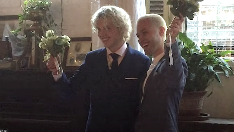 Cub Sport's Tim Nelson and Sam Netterfield on their wedding day in 2018. (Photo: YouTube)
