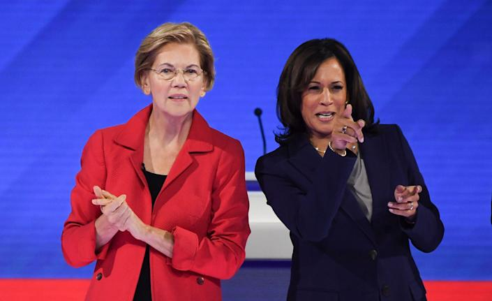 Sens. Elizabeth Warren and Kamala Harris take part in a Democratic primary debate in Houston on Sept. 12, 2019.