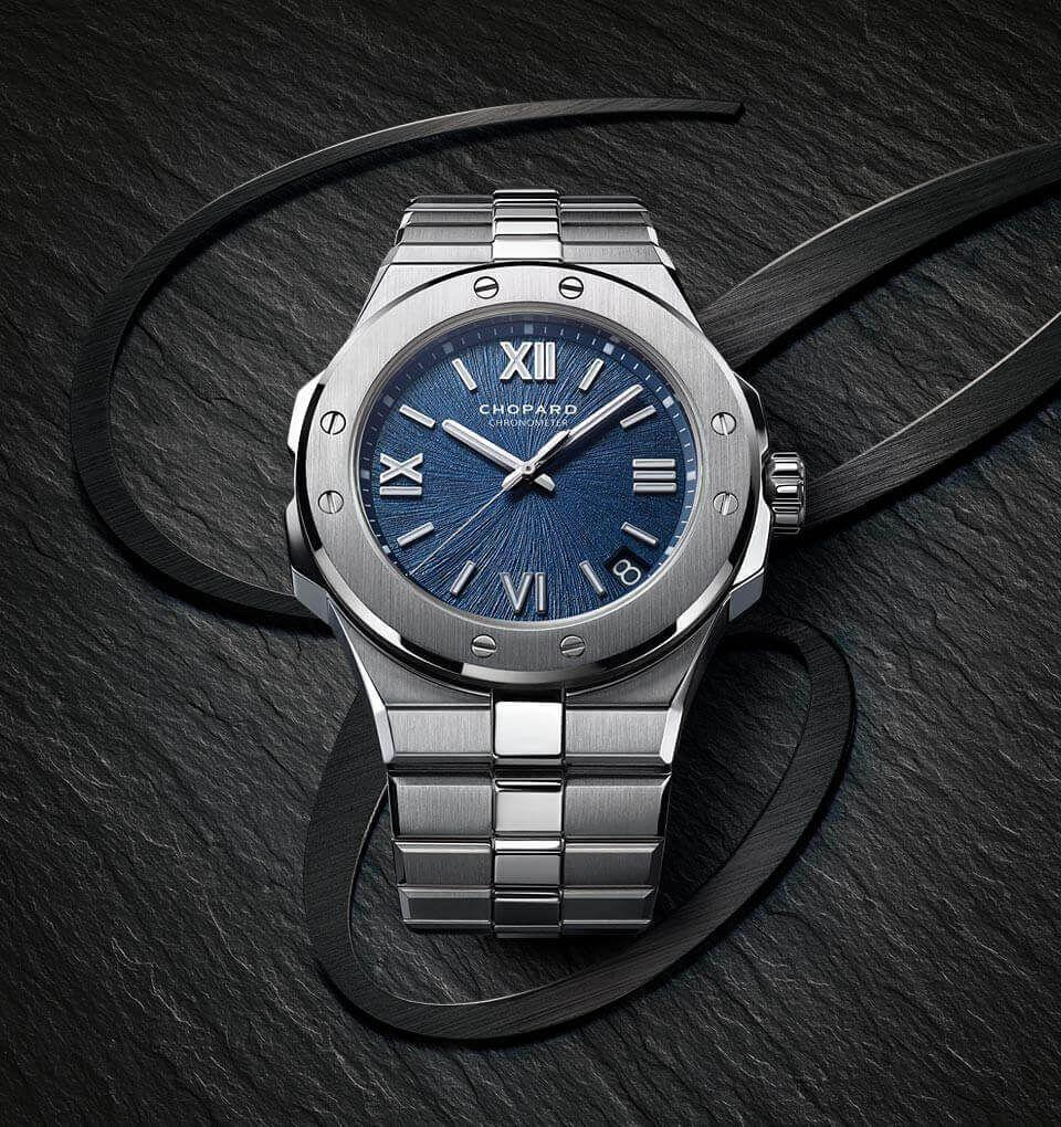 """<p>Alpine Eagle Automatic</p><p><a class=""""link rapid-noclick-resp"""" href=""""https://search.watches-of-switzerland.co.uk/search?isort=score&method=and&p=Q&pw=cgopard&rt=spelling&ts=custom&uid=379693220&w=chopard"""" rel=""""nofollow noopener"""" target=""""_blank"""" data-ylk=""""slk:SHOP"""">SHOP </a><br>Over the last few years, several companies have released watches with 'integrated bracelets' – that's to say, where the watch case and bezel flow continuously into a multi-linked bracelet, a trend that last took hold in the 1970s. Chopard's take is a reinterpretation of the St Moritz watch is launched 40 years ago, and is a particularly handsome piece. Simultaneously the rebirth of a watch icon, and the introduction of a new one, the Alpine Eagle Automatic also comes with 100 meter water resistance.</p><p>£10,400; <a href=""""https://search.watches-of-switzerland.co.uk/search?isort=score&method=and&p=Q&pw=cgopard&rt=spelling&ts=custom&uid=379693220&w=chopard"""" rel=""""nofollow noopener"""" target=""""_blank"""" data-ylk=""""slk:chopard.com"""" class=""""link rapid-noclick-resp"""">chopard.com</a></p>"""