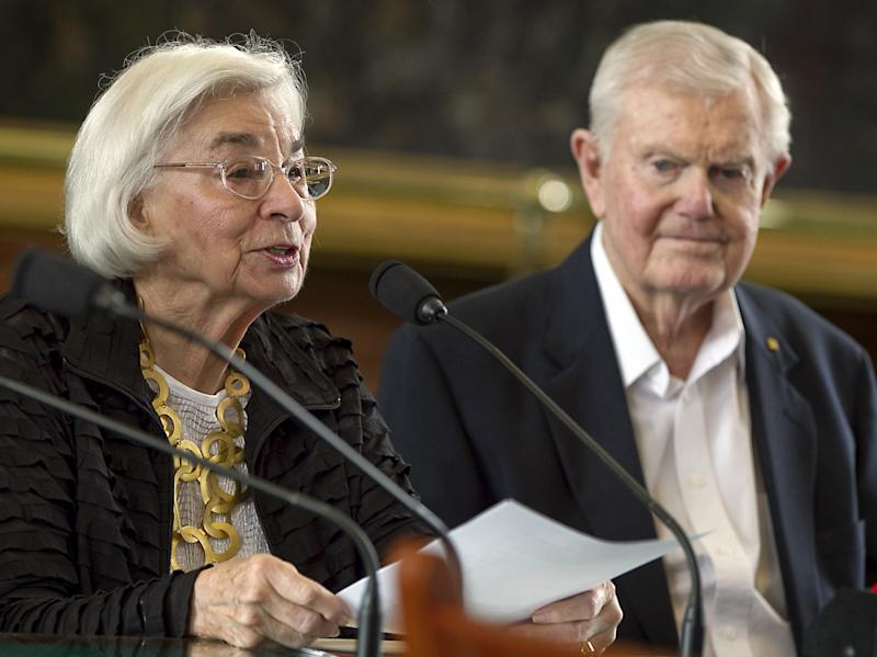 In this photo taken Feb. 28, 2012 , Edith Royal, wife of former Texas football coach Darrell Royal, right, announces that the family foundation named after her husband, DKR Fund for Alzheimer's Research, would fund Alzheimer's disease research in Texas during a joint legislative hearing held at the State Capitol in Austin, Texas. Royal, who won two national championships and turned the Longhorns program into a national power, died early Wednesday, Nov. 7, 2012, at age 88 of complications from cardiovascular disease, school spokesman Bill Little said. Royal also had suffered from Alzheimer's disease. (AP Photo/Austin American-Statesman, Rodolfo Gonzalez) MAGS OUT; NO SALES; INTERNET AND TV MUST CREDIT PHOTOGRAPHER AND STATESMAN.COM