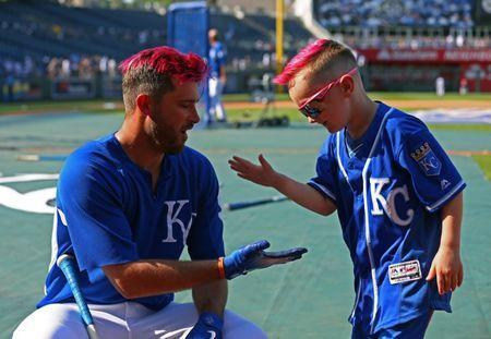 May 18, 2018; Kansas City, MO, USA; Kansas City Royals fan Dagan talks with catcher Drew Butera (9) before the game against the New York Yankees at Kauffman Stadium. Mandatory Credit: Jay Biggerstaff-USA TODAY Sports