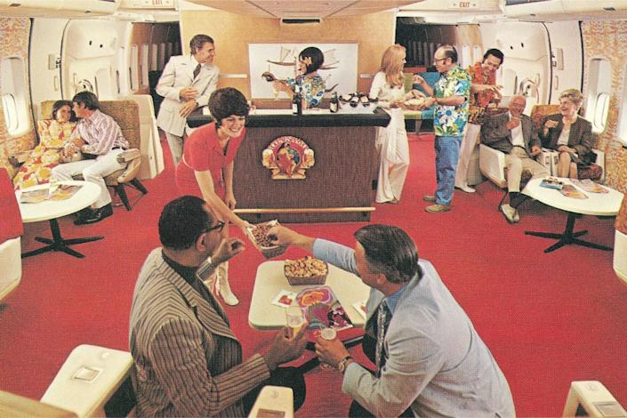 A waitress serving snacks in an airplane Party Lounge.