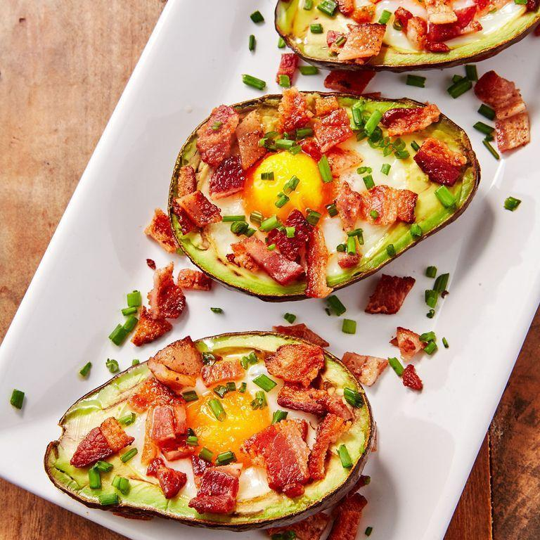 """<p><a href=""""https://www.delish.com/uk/cooking/recipes/a30323665/greek-stuffed-avocado-recipe/"""" rel=""""nofollow noopener"""" target=""""_blank"""" data-ylk=""""slk:Stuffed avocados"""" class=""""link rapid-noclick-resp"""">Stuffed avocados</a> are our favourite way to eat the power fruit. It's creamy texture pairs perfectly with a just set egg and crispy bacon. It's a power breakfast move or healthy snack that will keep you moving! </p><p>Get the <a href=""""https://www.delish.com/uk/cooking/recipes/a34434476/avocado-egg-boats-recipe/"""" rel=""""nofollow noopener"""" target=""""_blank"""" data-ylk=""""slk:Avocado Egg Boats"""" class=""""link rapid-noclick-resp"""">Avocado Egg Boats</a> recipe.</p>"""