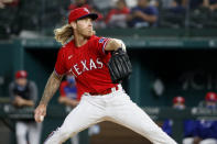 Texas Rangers starting pitcher Mike Foltynewicz throws during the first inning of the team's baseball game against the Baltimore Orioles in Arlington, Texas, Friday, April 16, 2021. (AP Photo/Roger Steinman)