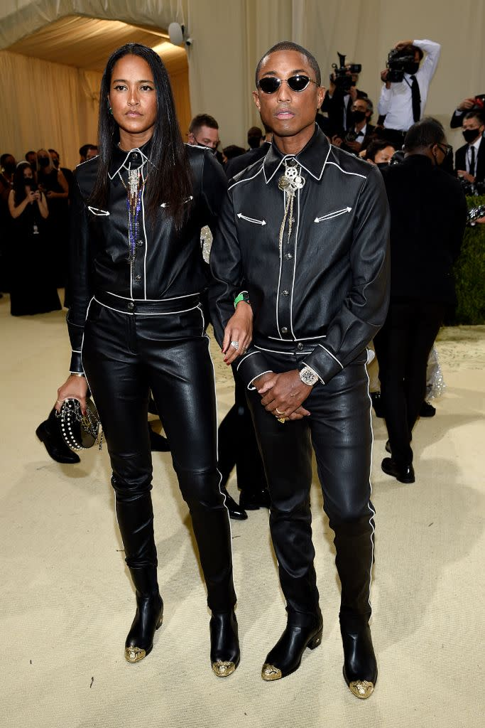 Helen Lasichanh and Pharrell Williams in matching Chanel Western looks. - Credit: AP Images