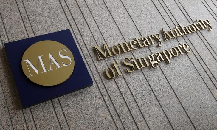 FILE PHOTO: The logo of the Monetary Authority of Singapore at its building in Singapore