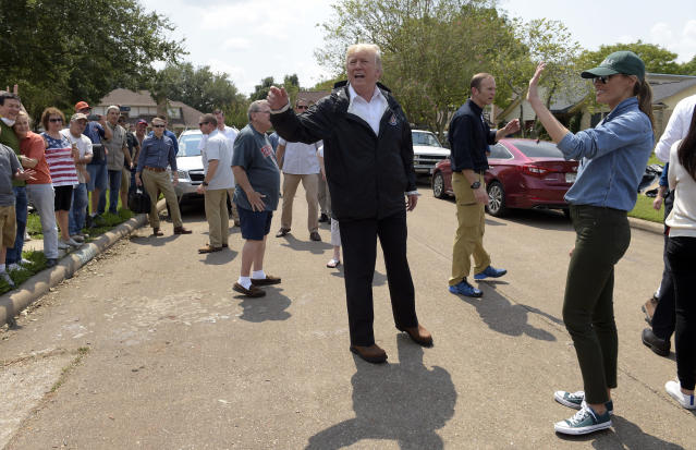 <p>President Donald Trump and first lady Melania Trump stop to talk with residents impacted by Hurricane Harvey in a Houston neighborhood, Saturday, Sept. 2, 2017. (Photo: Susan Walsh/AP) </p>