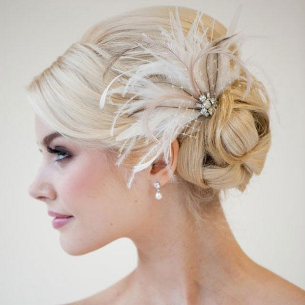 """<div class=""""caption-credit""""> Photo by: Etsy seller PowderBlueBijoux</div><div class=""""caption-title"""">5. Feather Frenzy</div>I have convinced my fiancé that my wedding dress is covered in feathers! (Maybe it is. He'll just have to wait and see.) Feathers are right on-trend and offer a soft, whimsical look to any wedding-day style. You'll find hair accessories featuring feathers in all shapes and sizes on Etsy, but I particularly love ones with rhinestone accents. <br> <br> <a rel=""""nofollow noopener"""" href=""""http://www.etsy.com/listing/83336418/bridal-fascinator-wedding-head-piece"""" target=""""_blank"""" data-ylk=""""slk:&quot;Olivia&quot; feather fascinator"""" class=""""link rapid-noclick-resp"""">""""Olivia"""" feather fascinator</a> by Etsy seller PowderBlueBijoux. <br> <br> <b>Related: <a rel=""""nofollow noopener"""" href=""""http://www.bridalguide.com/planning/david-tuteras-weddings/wedding-hair-dos-and-donts"""" target=""""_blank"""" data-ylk=""""slk:Wedding Hair Dos and Don'ts"""" class=""""link rapid-noclick-resp"""">Wedding Hair Dos and Don'ts</a></b>"""
