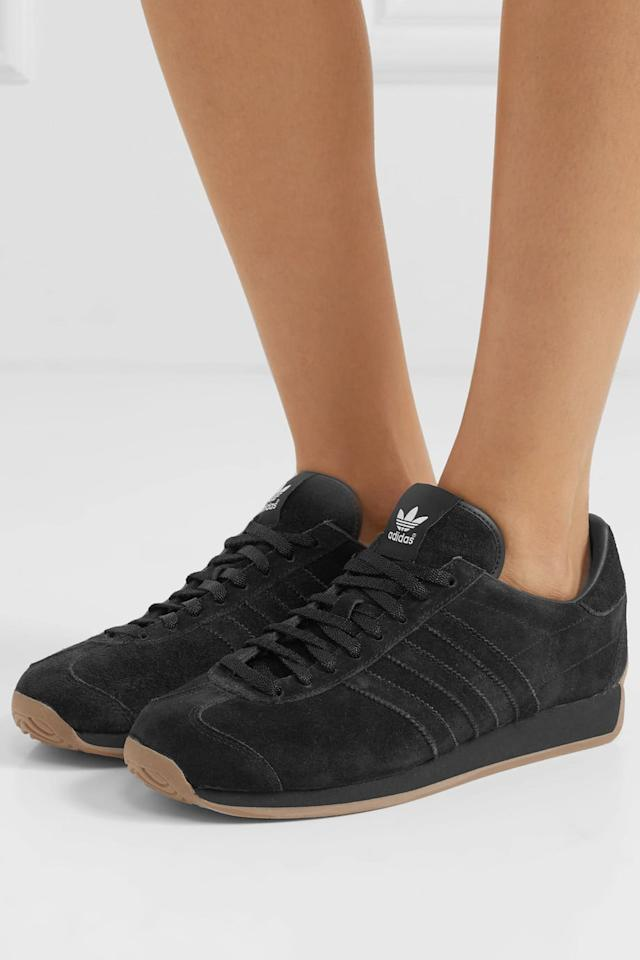 """<p><a href=""""https://www.popsugar.com/buy/Khaite---Adidas-Originals-suede-Sneakers-509671?p_name=Khaite%20-%20%2B%20Adidas%20Originals%20suede%20Sneakers&retailer=net-a-porter.com&pid=509671&price=200&evar1=fab%3Aus&evar9=44311634&evar98=https%3A%2F%2Fwww.popsugar.com%2Ffashion%2Fphoto-gallery%2F44311634%2Fimage%2F46920956%2FKhaite---Adidas-Originals-suede-Sneakers&list1=shopping%2Cshoes%2Csneakers%2Choliday%2Cgift%20guide%2Ceditors%20pick%2Cfashion%20gifts%2Cgifts%20for%20women&prop13=api&pdata=1"""" rel=""""nofollow"""" data-shoppable-link=""""1"""" target=""""_blank"""" class=""""ga-track"""" data-ga-category=""""Related"""" data-ga-label=""""https://www.net-a-porter.com/us/en/product/1185860"""" data-ga-action=""""In-Line Links"""">Khaite - + Adidas Originals suede Sneakers</a> ($200)</p> <p>""""I first noticed these sneakers when <a class=""""sugar-inline-link ga-track"""" title=""""Latest photos and news for Katie Holmes"""" href=""""https://www.popsugar.com/Katie-Holmes"""" target=""""_blank"""" data-ga-category=""""Related"""" data-ga-label=""""https://www.popsugar.com/Katie-Holmes"""" data-ga-action=""""&lt;-related-&gt; Links"""">Katie Holmes</a> was spotted wearing them out and about. The monochromatic all-black look is sleek yet wearable."""" - Lisa Sugar, founder and president, POPSUGAR</p>"""