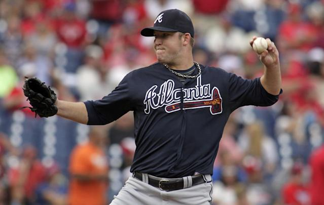 Atlanta Braves starting pitcher Paul Maholm throws against the Philadelphia Phillies in the first inning of a baseball game on Sunday, Sept. 8, 2013, in Philadelphia. (AP Photo/H. Rumph Jr)