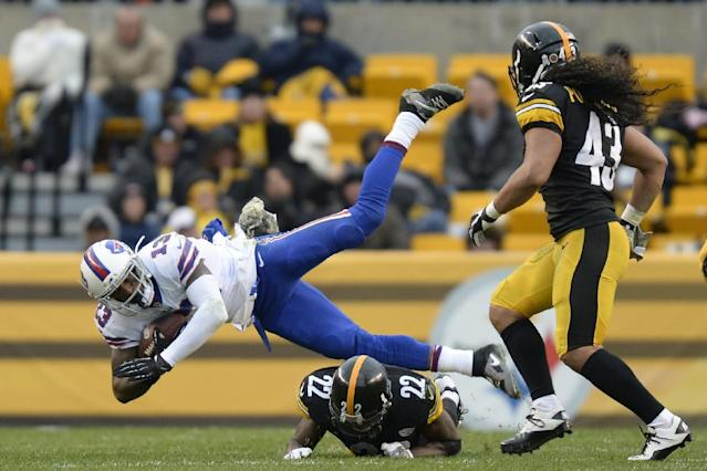 Buffalo Bills' Stevie Johnson (13) is sent flying by a Pittsburgh Steelers' William Gay (22) as Troy Polamalu (43) looks on during the second half of an NFL football game, Sunday, Nov. 10, 2013, in Pittsburgh. (AP Photo/Don Wright)