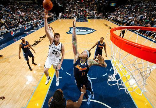 MEMPHIS, TN - FEBRUARY 17: Marc Gasol #33 of the Memphis Grizzlies shoots over Chris Andersen #11 of the Denver Nuggets on February 17, 2012 at FedExForum in Memphis, Tennessee. (Photo by Joe Murphy/NBAE via Getty Images)