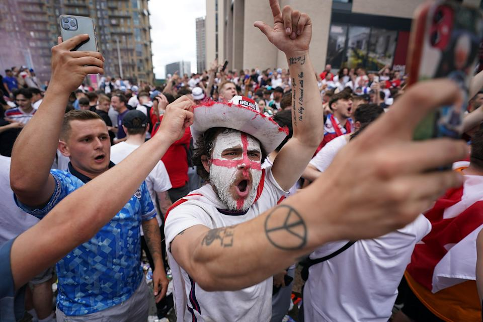 Fans have painted their faces in the nation's colours to show their support (Zac Goodwin/PA) (PA Wire)