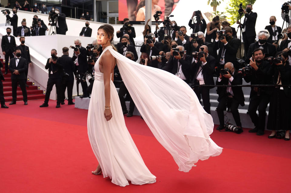 Noelle Capri poses for photographers upon arrival at the premiere of the film 'Everything Went Fine' at the 74th international film festival, Cannes, southern France, Wednesday, July 7, 2021. (AP Photo/Brynn Anderson)