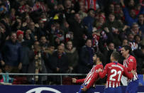 Athletico Madrid's Diego Costa, left, celebrates with teammates after scoring his side's opening goal during a Spanish La Liga soccer match between Atletico Madrid and FC Barcelona at the Metropolitano stadium in Madrid, Saturday, Nov. 24, 2018. (AP Photo/Manu Fernandez)