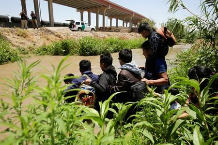 Migrants from Guatemala are seen on the banks of the Rio Bravo river before crossing illegally into the United States as seen from Ciudad Juarez