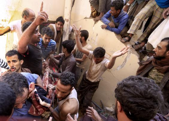 Yemenis carry a body recovered in the rubble of a destroyed building following reported Saudi-led coalition airstrikes in the Yemeni capital Sanaa on May 16 (Mohammed Huwais/AFP/Getty)