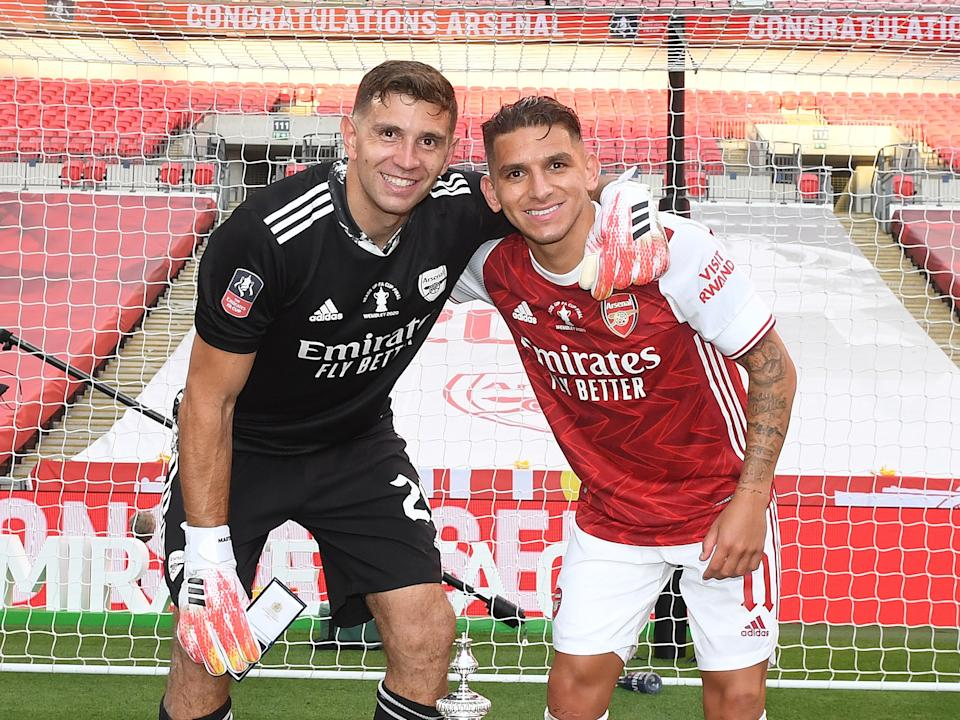 Martinez celebrates with Lucas Torreira after the FA Cup finalGetty