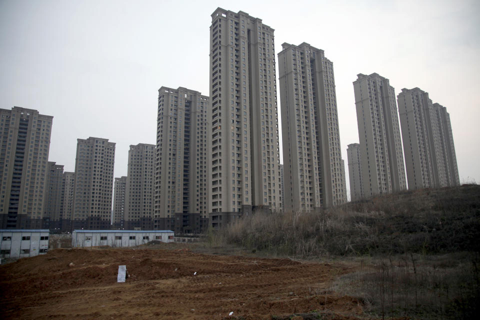 In this March 16, 2017 photo, the site of a planned mosque is seen near newly built apartment complex in Hefei in central China's Anhui province. On the dusty plains of the Chinese heartland, the bitter fight over a mosque illustrates how a surge in anti-Muslim sentiment online is spilling over into the real world. If left unchecked, scholars say, such attitudes risk inflaming simmering ethnic tensions that have in past erupted in bloodshed. (AP Photo/Gerry Shih)