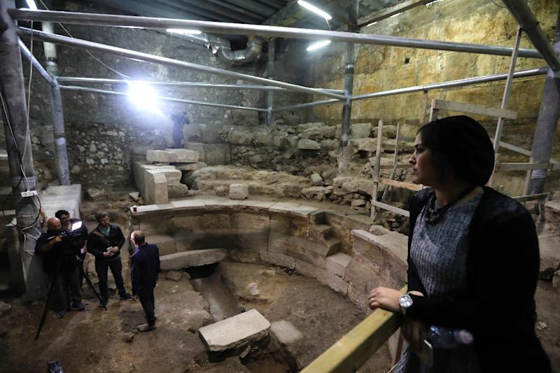 Reporters visit a recently discovered theatre-like Roman structure unearthed by the Israeli Antiquity Authority at the foot of the Western Wall tunnels in Jerusalem's Old City (AFP Photo/MENAHEM KAHANA)