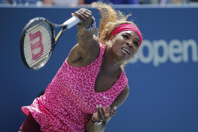 Serena Williams serves during her US Open match against Vania King on August 28, 2014 in New York