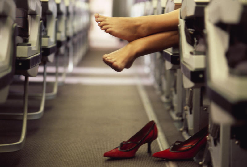 Woman's Feet in Airplane Aisle