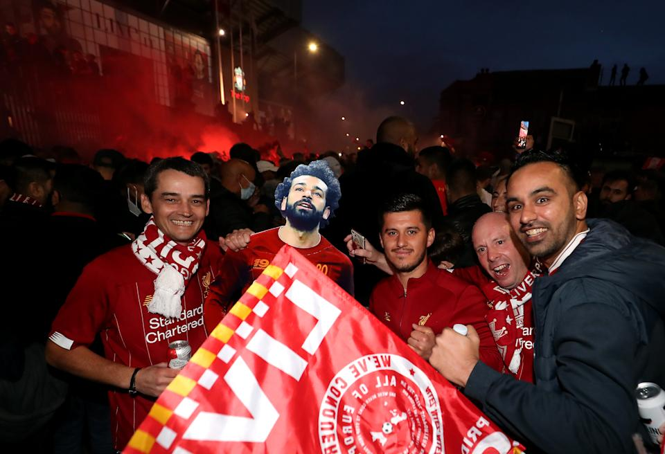 Liverpool fans celebrate outside Anfield. (Photo by Martin Rickett/PA Images via Getty Images)
