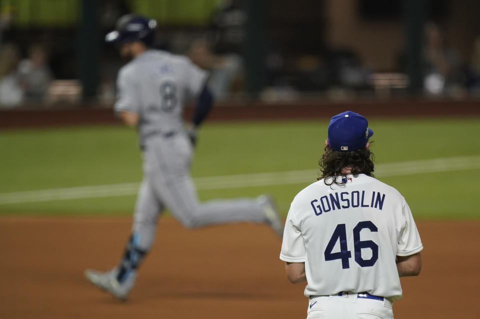 Tampa Bay Rays' Brandon Lowe rounds the bases after a home run off Los Angeles Dodgers starting pitcher Tony Gonsolin during the first inning in Game 2 of the baseball World Series Wednesday, Oct. 21, 2020, in Arlington, Texas. (AP Photo/Eric Gay)