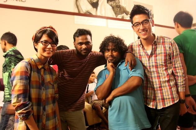 Lead vocalist Moxi Looi (left) and Guan Xian (right) pose with Osman and Jahangir. (Photo courtesy of Bernice Wong)
