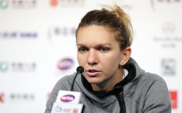 Simona Halep is suffering with a lower back injury - Visual China Group