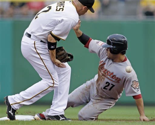 Pittsburgh Pirates shortstop Clint Barmes, left, can't handle the throw from catcher Michael McKenry as Houston Astros' Jose Altuve (27) steals second during the first inning of a baseball game in Pittsburgh on Thursday, July 5, 2012. (AP Photo/Gene J. Puskar)