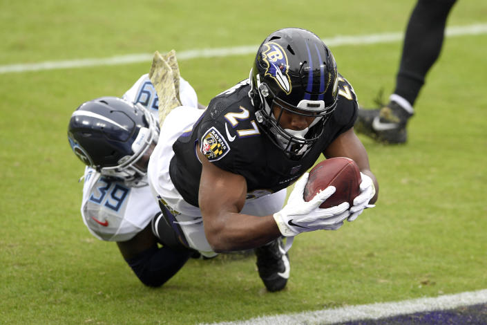 Baltimore Ravens running back J.K. Dobbins (27) dives into the end zone as Tennessee Titans cornerback Breon Borders tries to stop him on a 2-point conversion catch during the first half of an NFL football game, Sunday, Nov. 22, 2020, in Baltimore. (AP Photo/Nick Wass)